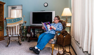 Reading in Brown Wilcox Assisted Living family room